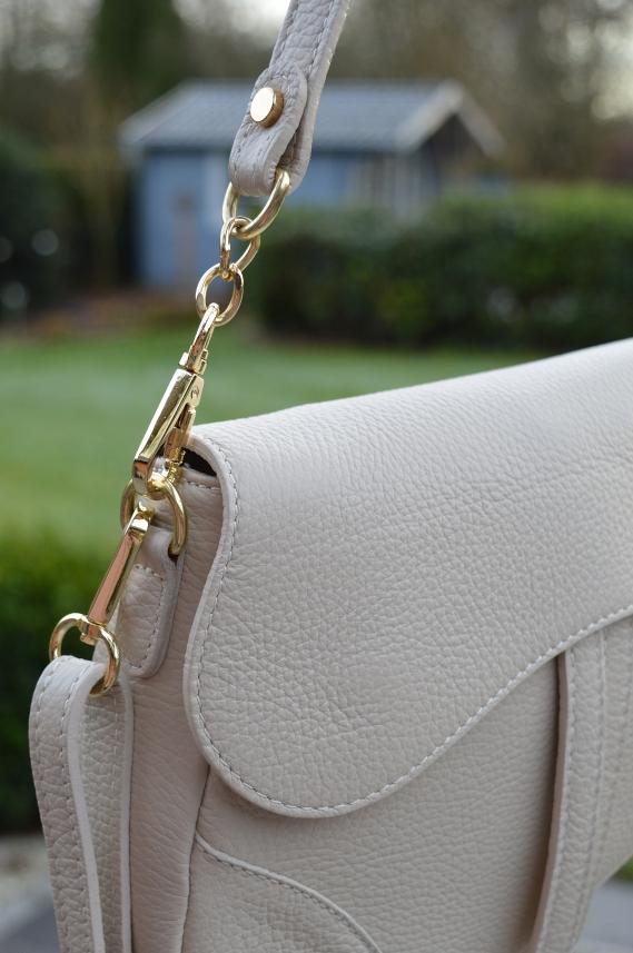Ähnlichkeit mit Dior Saddle Tasche